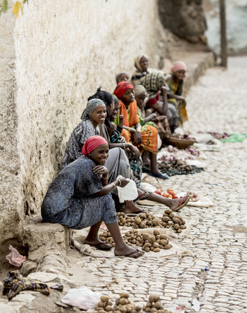 HARAR, ETHIOPIA-MARCH 26, 2017: Unidentified women sell vegetables on the street in Harar, Ethiopia