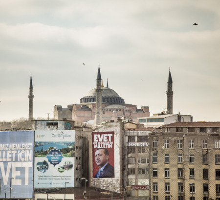 ISTANBUL, TURKEY-APRIL 1, 2017: A political poster for President Recep Tayyip ErdoÄŸan decorates a wall in front of the Hagia Sophia.