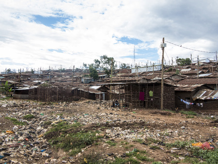 Open sewer and shacks in Kibera, the largest urban slum in Africa