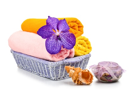Towels, shell and flower isolated on a white background Stock Photo