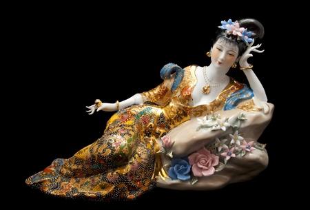Chinese statuette geisha on black background