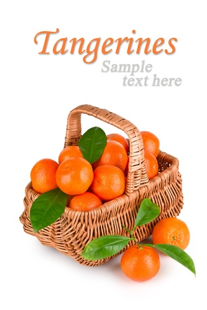 Ripe tangerines with leaves in basket on white background with sample text photo