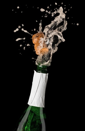Champagne bottle with shooting cork, on black background Stock Photo - 11681119