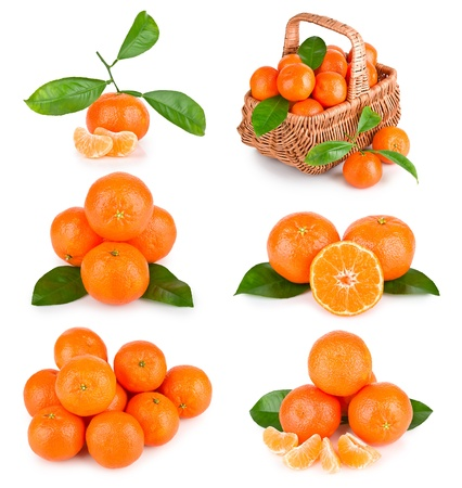 Set of fresh mandarin fruits with cut and green leaves isolated on white background photo