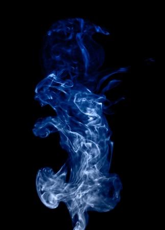 Blue smoke isolated on black Stock Photo