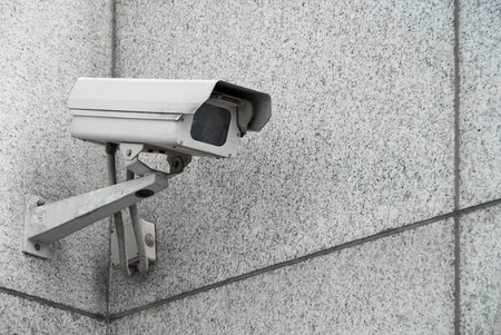 Outdoor surveillance camera on the facade of the building photo