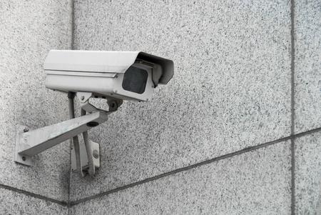 Outdoor surveillance camera on the facade of the building Stock Photo