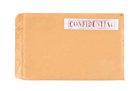 Used postal Confidential envelope, isolated on white background photo