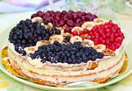 Berry homemade tart on platter on table