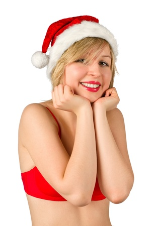 Christmas girl in red santa hat, isolated on white background photo