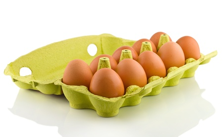Ten eggs in package, on white background photo