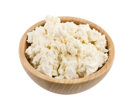 Fresh cottage cheese in bowl isolated on white
