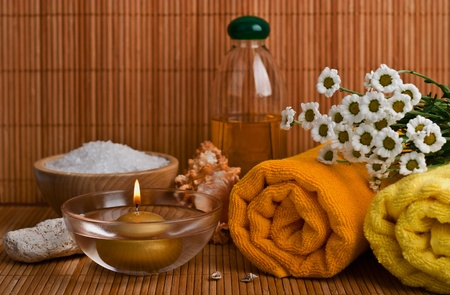 Spa style Towel with Bamboo, bowl of sea salt and candle  photo