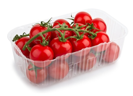 Red Cherry Tomatoes In Plastic Retail Supermarket Packaging isolated on white background photo