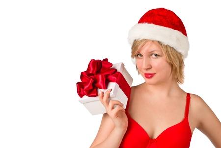 Christmas girl holding gift wearing Santa hat isolated on white background Stock Photo - 11919648