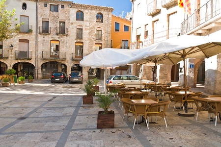 Empty cafe in the medieval town of Besalu, Catalonia, Spain Editorial
