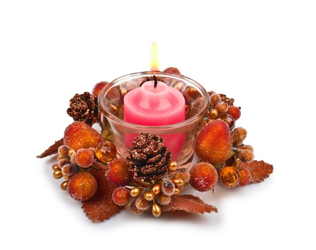 Candle in a Christmas candlestick isolated on white background photo