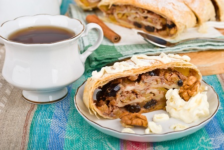 Breakfast with the apple strudel with tea, close-up photo