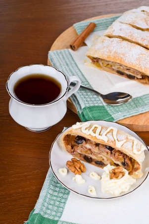 Breakfast with the apple strudel with tea photo