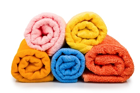 Multicolour towels rolls on white background