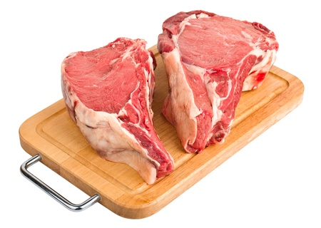 raw meat   fresh beef pork big rib and fillet on wooden board, isolated over white background Stock Photo