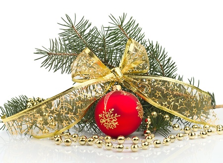 pine needles close up: Bright christmas composition with ball with bow on white