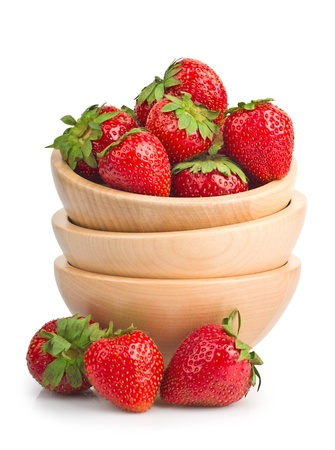 sweet ripe strawberries in wooden bowls isolated on white  photo