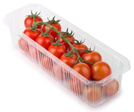 Red Cherry Tomatoes in plastic Retail Supermarket Packaging, isolated on white background photo