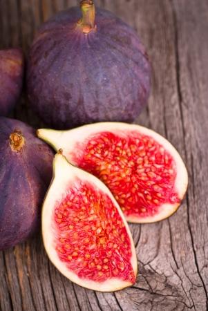 Fresh figs on wooden ground