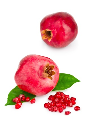 Ripe pomegranate fruit isolated on white background photo