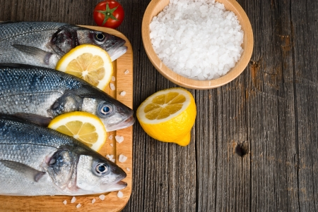 fresh, raw sea bass on the catching board Stock Photo - 20194813