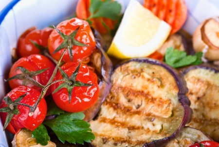 baked aubergines with tomatoes and vegetables, macro Stock Photo