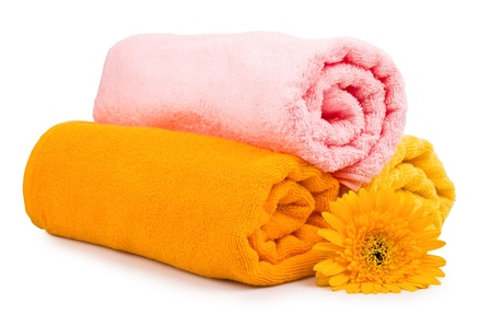 Colorful towels with flower. Isolated on white background