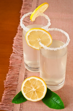 Glass of fresh homemade tasty lemonade on wooden table
