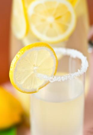 lemonade in glass with lemon, closeup Stock Photo