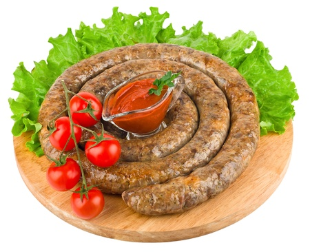 Ring of fried sausage from the pork stuffing isolated on a white background