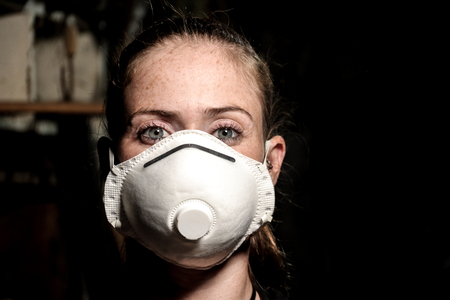 young girl with dust mask