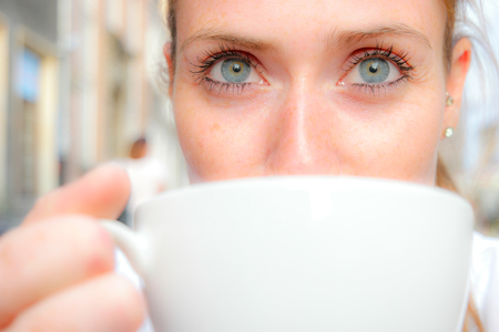young women drinks coffee Stock Photo