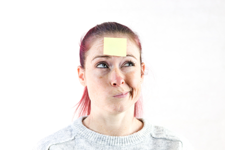 young women with sticky note on brow