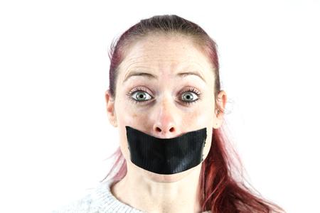 young women with sealed mouth Фото со стока