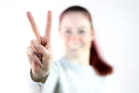 young women makes victory sign