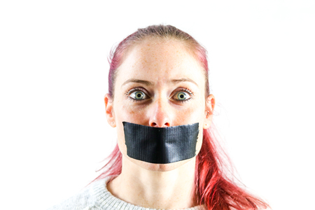 young women with sealed mouth Stock Photo