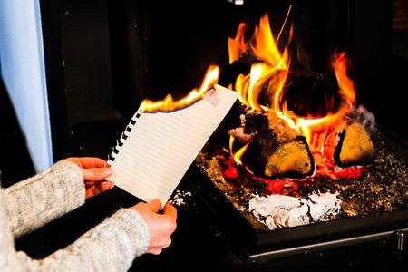 young women burns a sheet of paper