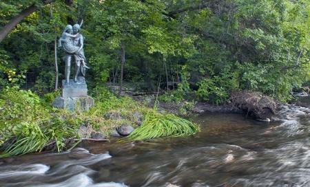 Hiawatha protects Minnehaha in this statue overlooking Minnehaha Creek  photo