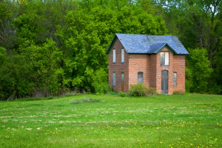 An abandoned brick farmhouse on the Midwest United States Prairie  photo