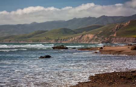 Waves arrive on shore at Jalama Beach near Santa Barbara, California. photo