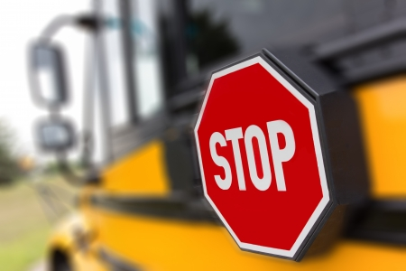 The stop sign on a public school bus.