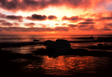 Magnificant Pacific Ocean Sunset at Crystal Cove Beach, California photo
