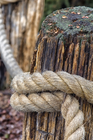 A thick rope tied around a post