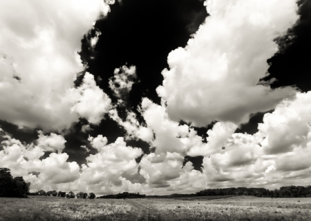 The Wisconsin rural countryside reveals huge cumulus clouds
